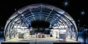 Un padiglione temporaneo al TENSINET Symposium realizzato con profili TRIGLASS®